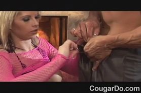 Big breasted blonde cougar in pink  fisnet takes it up